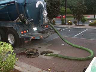 Pump truck emptying grease interceptor