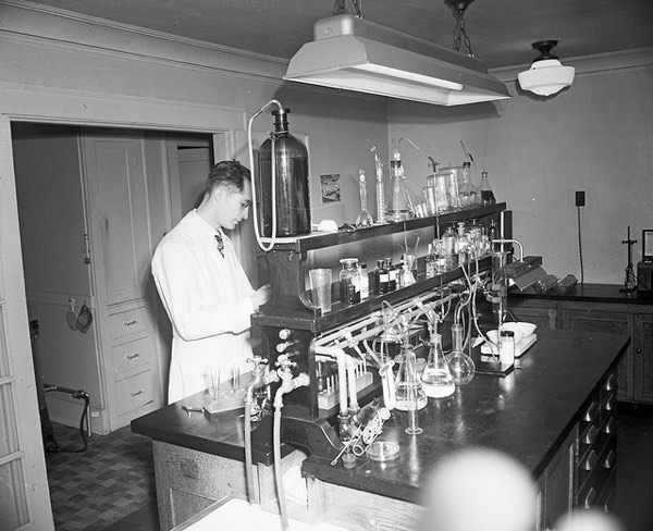 Historic photo of water testing in Seattle municipal lab